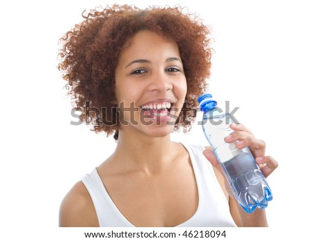 Happy african girl drinking water