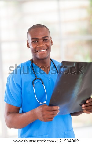 happy african hospital worker with x-ray