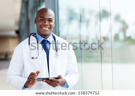 happy african male doctor with tablet computer