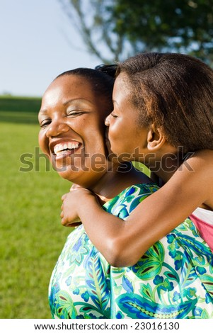 happy african mother and daughter together