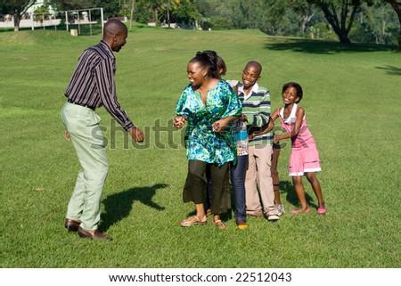 happy african playing a game together
