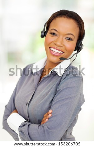 happy afro american business call center operator with arms crossed