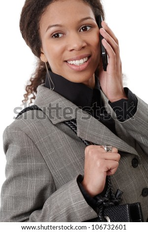 Happy afro-american businesswoman talking on mobile phone, smiling.