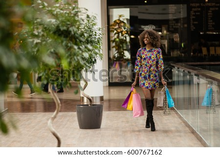 happy afro woman in a shopping...