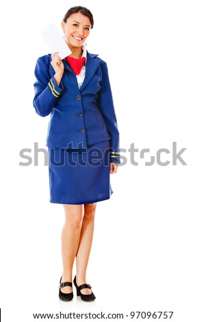 Happy air hostess holding ticket  - isolated over a white background
