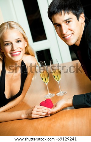 Happy amorous couple and a special man proposal in restaurant