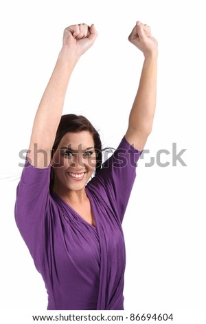 Happy and beautiful brunette woman with arms raised and celebrating