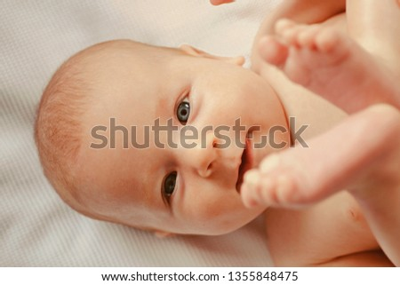 Happy and carefree. Newborn baby happy smiling. Newborn baby girl or boy. Be like me, be carefree.