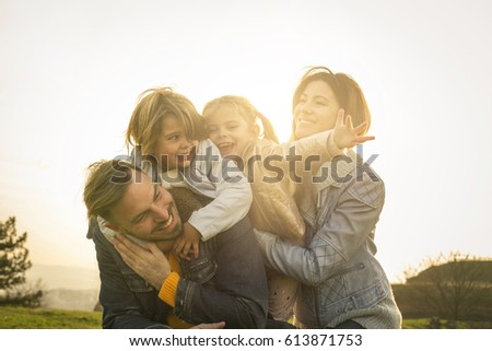 Happy and  cheerful family enjoy in the park. #613871753