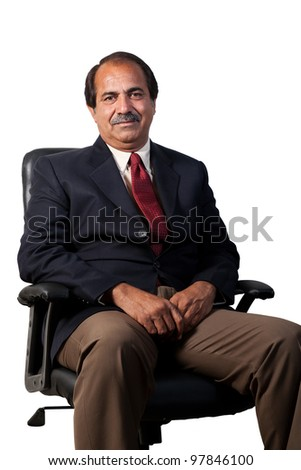 happy and confident senior businessman sitting in the office chair isolated on white background, mature businessman sitting in office chair