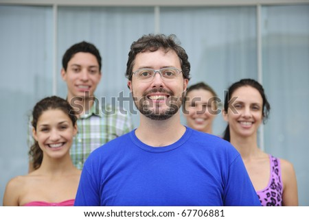 happy and diverse group of casual real people, mid adult man in front