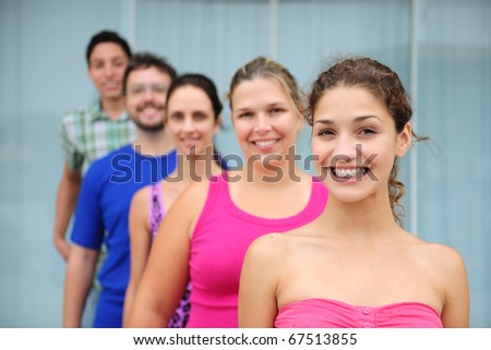 happy and diverse group of casual real people, teenage girl in front