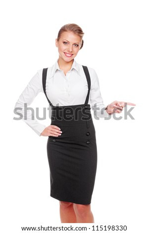 happy and friendly woman pointing at something over white background