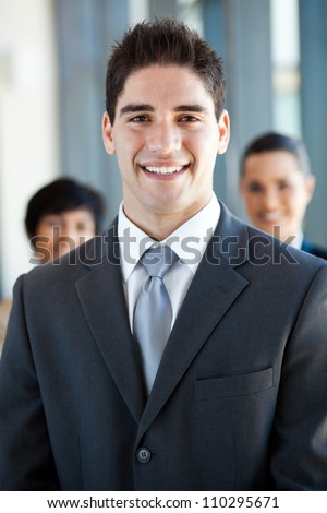 happy and handsome young businessman and co-worker - stock photo