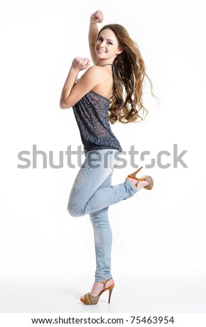Happy and joy beautiful girl in fashion stylish jeans - isolated on white.  Fashion model posing at studio