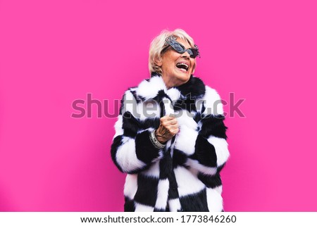 Happy and playful senior woman having fun - Portrait of a beautiful lady above 70 years old with stylish clothes, concepts about senior people Foto d'archivio ©