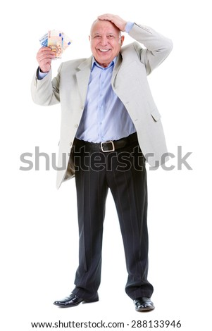 Happy and smile old mature businessman in suit, hold euro money in hand and put second hand over head, isolated on white background. Positive human emotion, facial expression