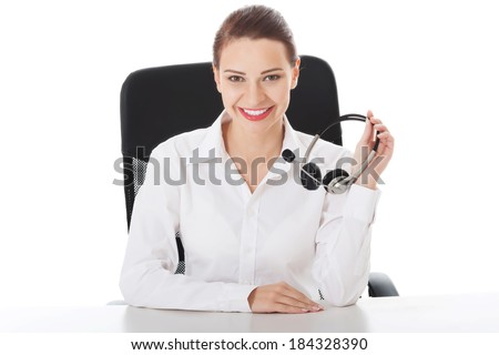 Happy and smiling business woman at call center. Isolated on white.