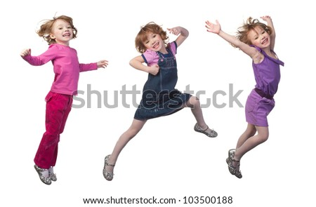 Happy and smiling girl jumping, over white