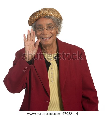 Happy and Smiling Senior Woman Waving with her hand. Shot against white background.