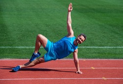 Happy and sporty. male athlete do morning exercise. warm up workout. sportsman flex muscles outdoor. muscular guy do stretching. man in yoga pose. sports and healthy lifestyle routine. sport success.