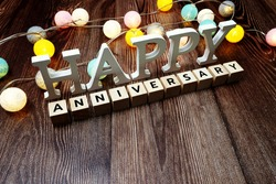 Happy Anniversary alphabet letter with LED cotton balls on wooden background