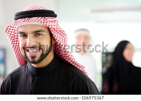 Happy Arabic man at work smiling
