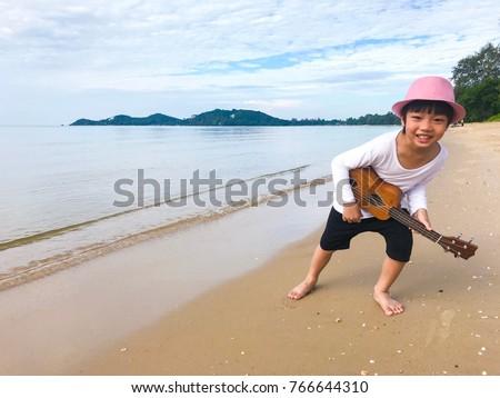 happy asia cute little boy...