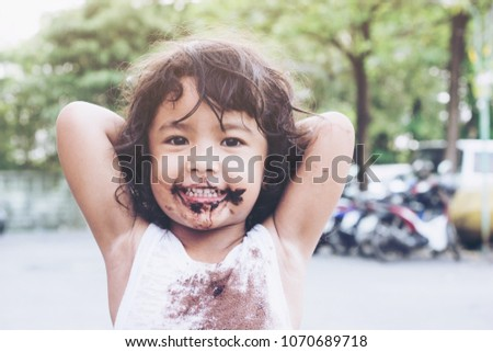 Happy Asia girl her mouth aftertaste from eating a chocolate dessert