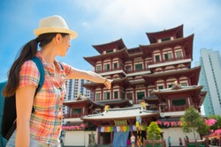Happy Asia woman Travel in Singapore, Pointing Buddha Tooth Relic Temple