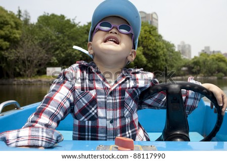 happy Asian baby boating in the lake