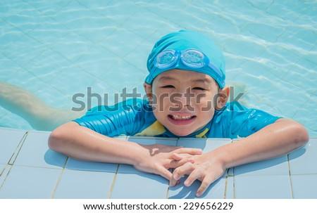 Happy Asian boy in swimming pool