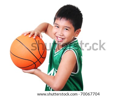 happy asian boy playing basketball