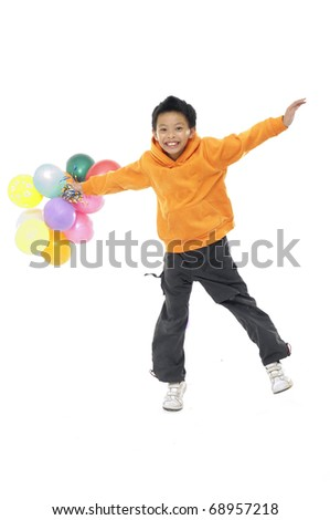 Happy asian boy with colorful balloons jumping