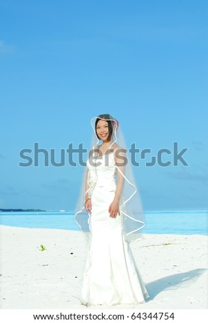 happy asian bride on tropical beach