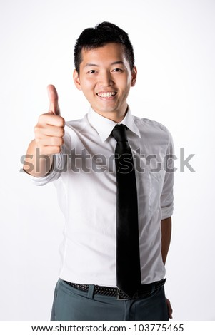 Happy Asian business man with thumbs up.