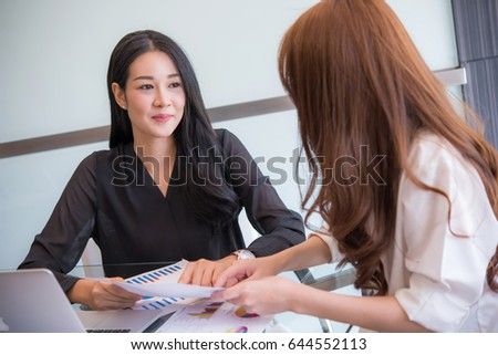 Happy asian business woman working at office   - Shutterstock ID 644552113