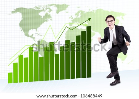 Happy asian businessman celebration his success. shot over global business chart - stock photo