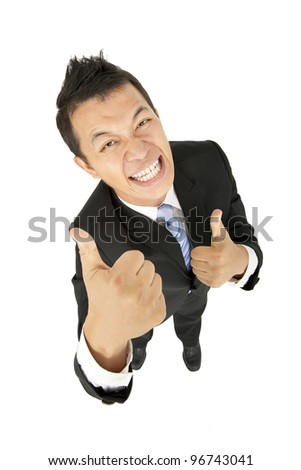 happy asian businessman with thumbs up