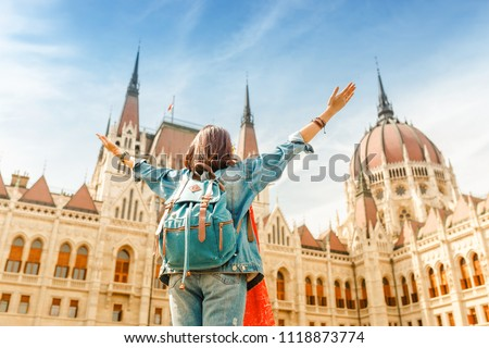 Happy asian casual woman student enjoying great view of the Parliament building in Budapest city, travel in Europe concept #1118873774