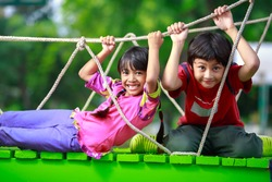 Happy asian child playing together on playground