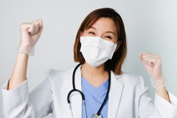 happy asian doctor wear the medical mask to protect and fight infection from germ, bacteria, covid19, corona , sars , influenza virus on white background with the happy face.