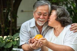 Happy asian elderly couple smiling health care with fruit, old elderly man and woman have a happy life after retirement , People lifestyle concept.
