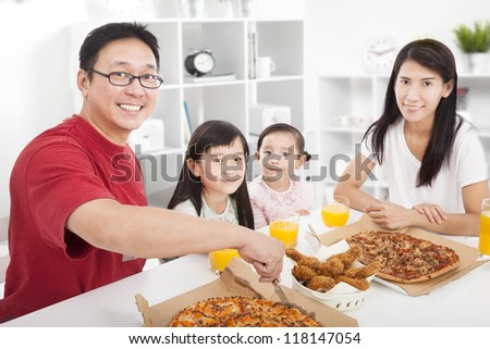 happy asian Family enjoy their dinner in the home