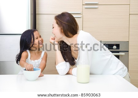 Happy Asian Family having breakfast together in the morning