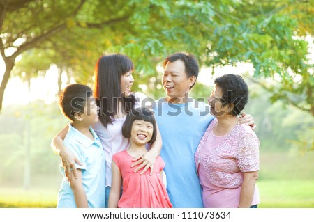 Happy Asian family having conversation at outdoor