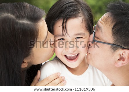 happy Asian family in kissing