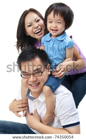 Happy Asian family on white background - stock photo