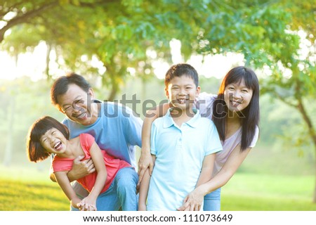 Happy Asian Family Outdoor Lifestyle