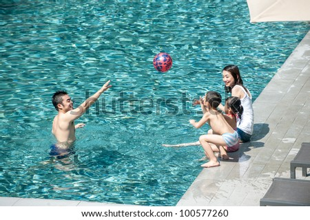 Happy Asian Family Playing in the pool